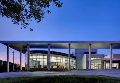 Lady Bird Johnson Middle School exterior at night showing architecture.
