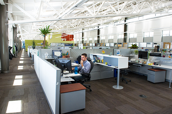 Photo of the interior of office building. Designed with energy saving appliances, recycled materials, using the LightLouver (TM) Daylighting System units installed in the daylight windows to redirect sunlight deep into the office space and utilizing available light, provides a comfortable ambient light for NREL employees working in the Research Support Facility. (Photo by Dennis Schroeder / NREL)